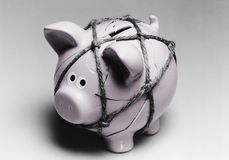 Broken piggy bank reassembled with twine Royalty Free Stock Image