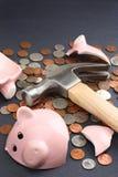 Broken piggy bank with savings money Royalty Free Stock Image