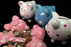 Broken Piggy Bank With Three Little Pigs. Three very sad piggy banks looking at broken friend Royalty Free Stock Image
