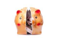 Broken piggy bank  on white background Stock Images