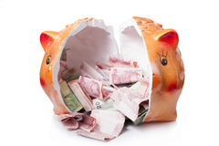 Broken piggy bank  on white background Royalty Free Stock Photography