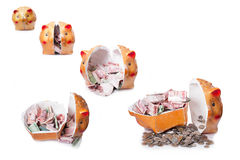 Broken piggy bank  on white background Royalty Free Stock Photo