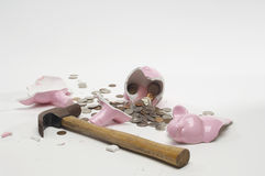 Broken Piggybank With Hammer And Coins Stock Images