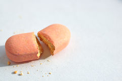 Broken pill. A pill broken on the middle Royalty Free Stock Image