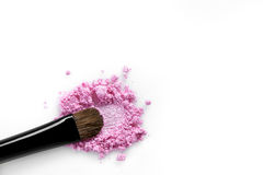 Broken pink eye shadow and brush isolated on white background royalty free stock images