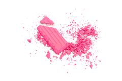 Pink broken Eye shadow set isolated on white. A broken pink eye shadow make up palette isolated on a white background. Top view, flat lay. Copy space for your royalty free stock photos