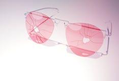 Broken pink glasses Royalty Free Stock Photos