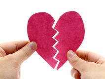 Broken pink heart on hand Stock Photos