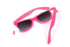 Broken pink sunglasses. Stock Images