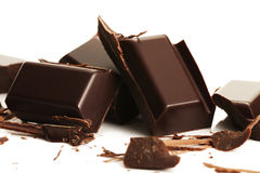 Broken plain chocolate pieces Royalty Free Stock Images
