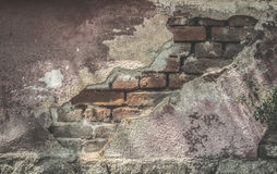 Broken plaster and brick wall. Sunlight Royalty Free Stock Images