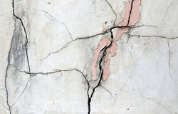 Broken plastered and painted wall Stock Images