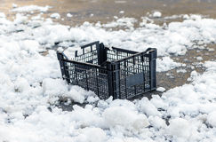 Broken plastic crate isolated on snow background Stock Image