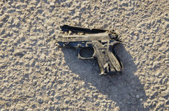 Broken plastic gun on asphalt Stock Image