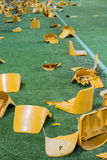 Broken plastic seats after match on stadium Stock Photography