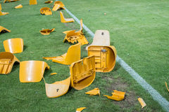 Broken plastic seats after match on stadium Stock Image
