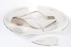 Broken plate and bent silver Royalty Free Stock Photos