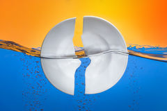 Broken plate concept in water. Added ripple affect Stock Photography