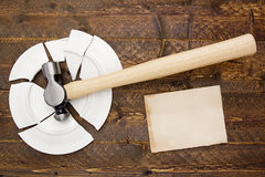 Broken plate and hammer Stock Photography