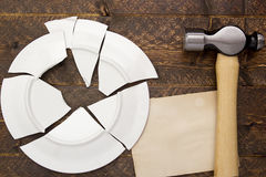 Broken plate and hammer Royalty Free Stock Photo