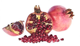 Broken pomegranate with seeds Stock Images