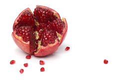 Broken pomegranate and seeds Stock Photos