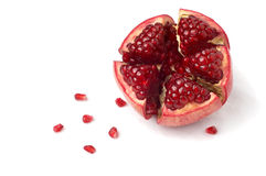 Broken pomegranate and seeds Royalty Free Stock Image