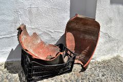 Broken pot in the street of Frigiliana, Spanish white village Andalusia. Beautiful and charming with its narrow streets and footpaths white village Frigiliana Stock Photos