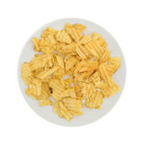 Broken potato chips on a plate Stock Image