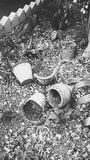 Broken pots. The black and white photo of the mud pots giving up a antiquitic look Royalty Free Stock Photos