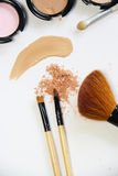 Broken powder, foundation and brushes Royalty Free Stock Image