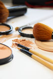 Broken powder, foundation and brushes Stock Photography