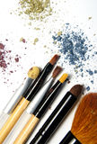 Broken powder, foundation and brushes Royalty Free Stock Photo