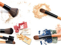 Broken powder, foundation and brushes on the white background. Royalty Free Stock Photography