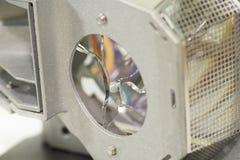Broken projector lamp, closeup. Closeup view of broken crystal of projector lamp stock images