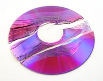 Broken purple DVD Royalty Free Stock Image