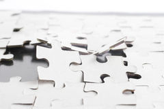 Broken puzzle. (with some parts already missing stock image