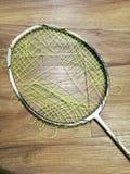 Broken racket. Broken badminton racket royalty free stock photos