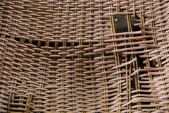 A broken rattan chair Royalty Free Stock Images