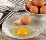 Broken raw  egg on a wooden background Royalty Free Stock Images