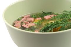 Broken raw eggs with sausage Stock Images