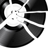 Broken record. Black vinyl record with white label broken into pieces Royalty Free Stock Image