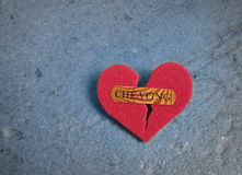 Broken red cheating heart Stock Photo