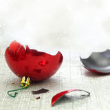 Broken red Christmas ornament. With bokeh background stock photos