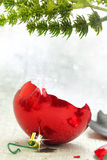 Broken red Christmas ornament royalty free stock photo