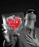 Broken red glass heart businessman metaphor Royalty Free Stock Image