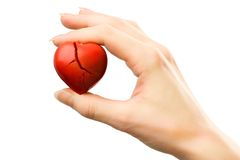 Broken red heart in hand Royalty Free Stock Photos