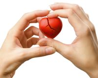 Broken red heart in hands Royalty Free Stock Images