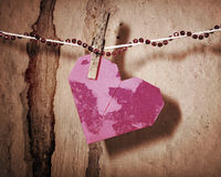 Broken red heart hung on rope Stock Photos