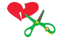 Broken red heart and scissors Royalty Free Stock Image